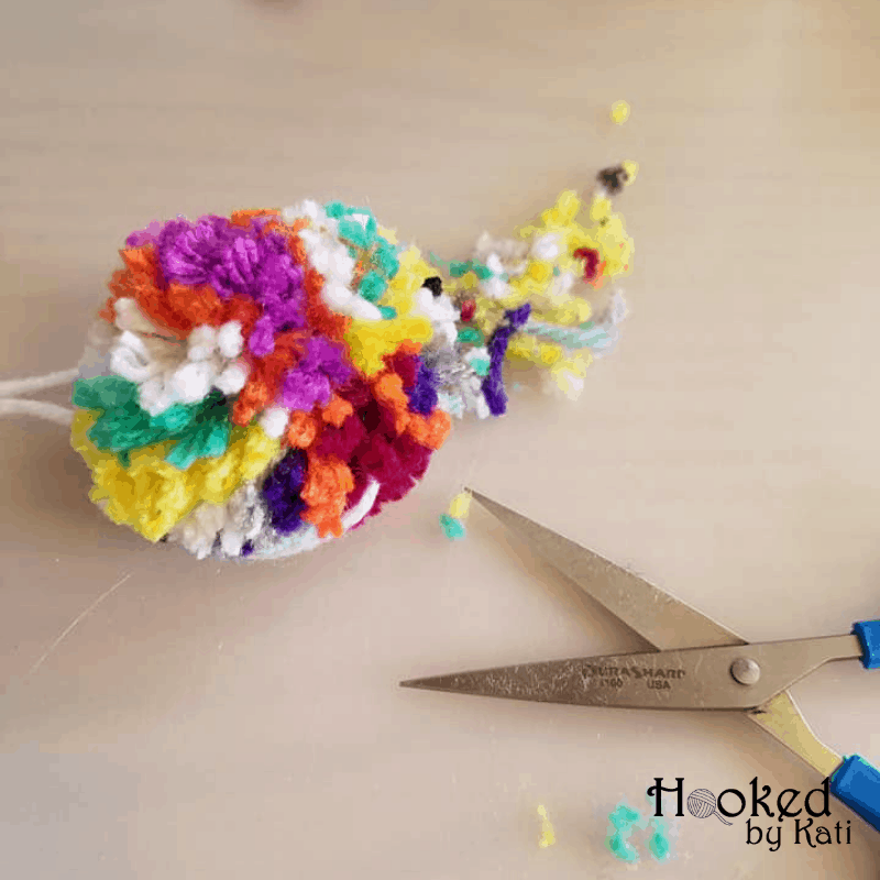 10 minute dollar store tutorial for pom pom planner clip, scrap buster, simple project
